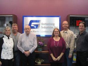 Enjoying their new office space, located in Garnavillo, Iowa are Guttenberg Industries, Inc., founders Pat and John Ertl, left, with son Jim Ertl (back), daughter Deb Moser, son Tom Ertl, and president David Kreul. (Press photo by Molly Moser)